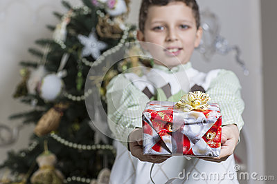 Boy gives Christmas gift