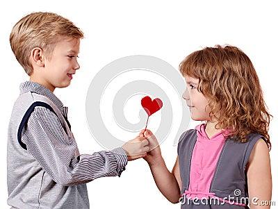 Boy gives a little girl heart