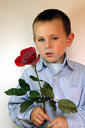 Boy giving flowers