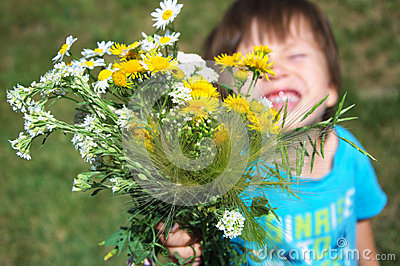 Boy giving flowers