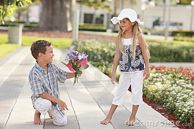 Boy giving flowers to the girl