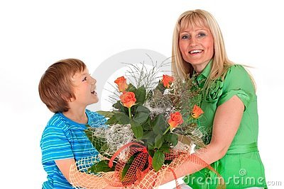 Boy giving flowers to mom