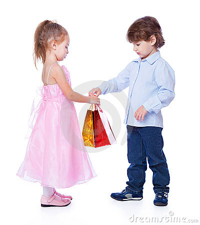 A boy is giving the gift to a girl
