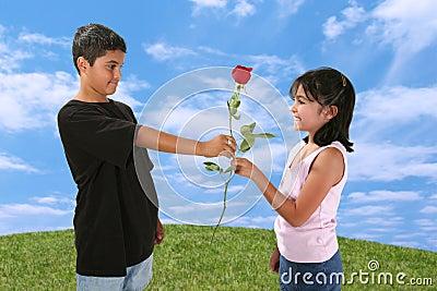 Boy Giving Girl a Rose