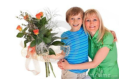 Boy giving mother flowers