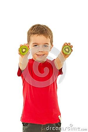 Boy giving slices kiwi