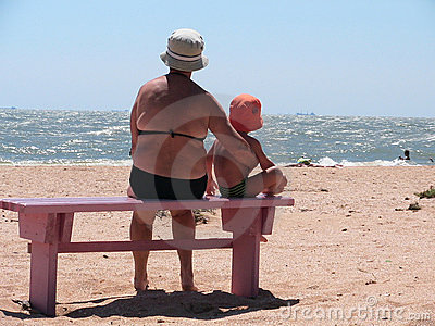 Boy with grandmother on beach Editorial Photo