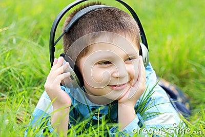 Boy in grass enjoying music