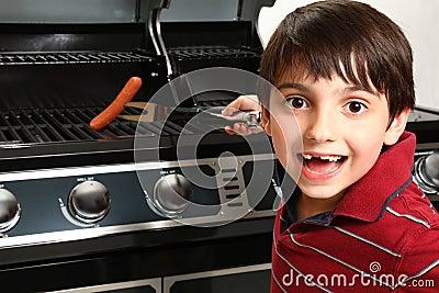 Boy Grilling Up a Hotdog