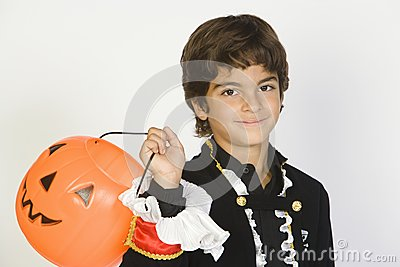 Boy In Halloween Outfit Holding Jack-O-Lantern