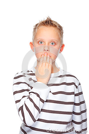 Boy with hand before mouth