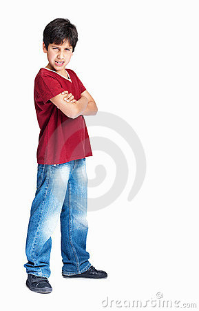 Boy with hands folded standing with attitude