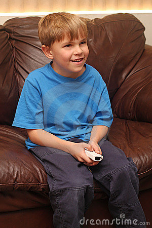 Boy happily plays video game