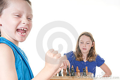 Boy happy about chess game