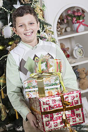 Boy is happy with many Christmas gifts