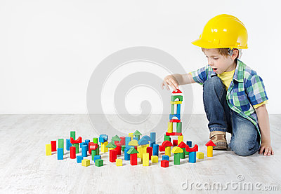 Boy in hard hat playing with blocks