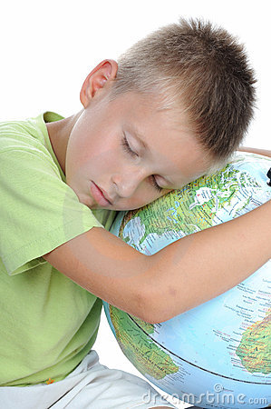 Boy has tired and sleeps on globe