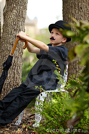 Boy with hat and umbrella