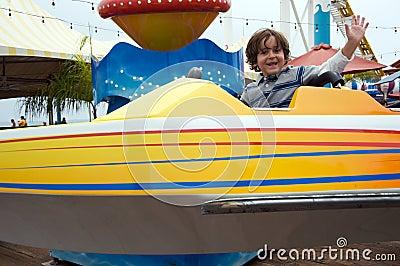 Boy having fun at an amusement park