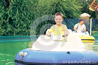 Boy having fun with bumper boats