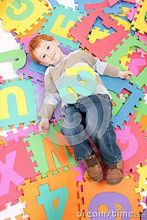 Boy having fun learning kids alphabet letters