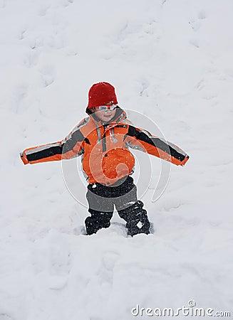 Boy having great fun in snow