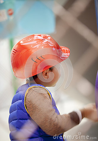 Boy with helmet roleplay construction worker