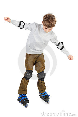 Boy in helmet with at sides and rollerblading
