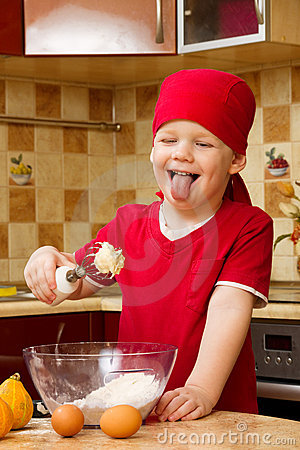 Boy helping at kitchen with baking pie