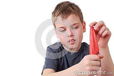 Boy hides shawl in fist is focus