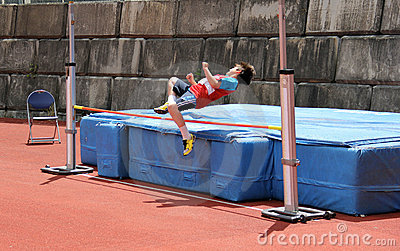 Boy in high jump.