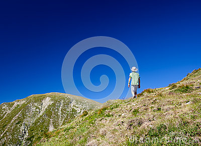Boy hiking into the mountains