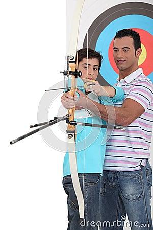 Boy with archery coach