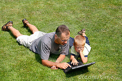 Boy and his father s working on laptops