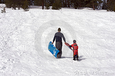 Boy and his father sledding