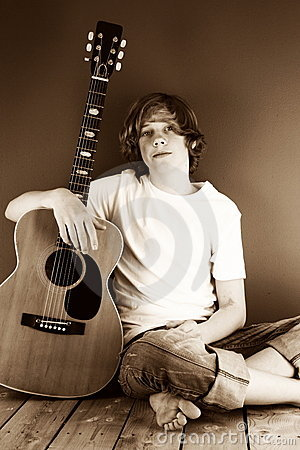 Boy With His Guitar In Sepia