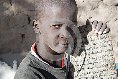 Boy and his manuscript in Arabic Editorial Photo