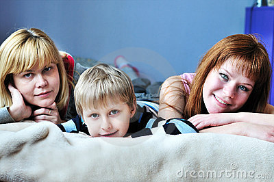 Boy with his sister and mother