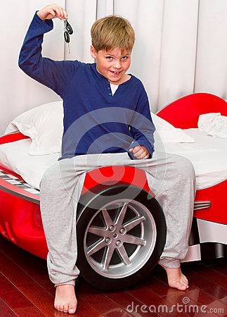 Boy and his supercar bed with keys