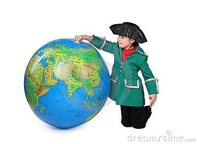Boy in historical dress near big globe isolated