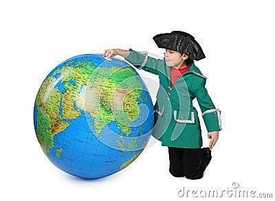 Boy in historical dress near big globe isolated