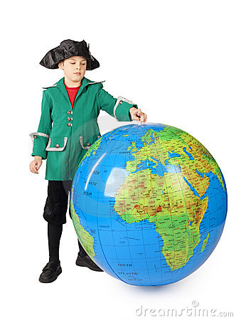 Boy in historical dress standing with big globe