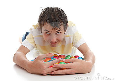 Boy hoarding easter eggs