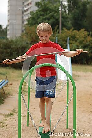 Free Boy Holding A Balance Stock Image - 49010411