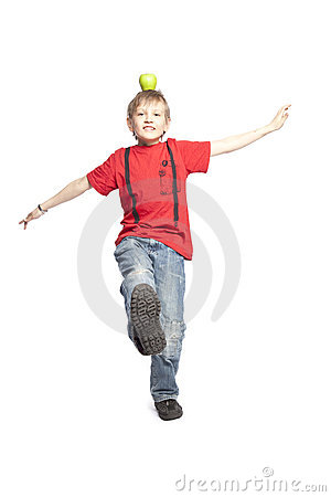 Free Boy Holding Apple Over His Head Royalty Free Stock Photos - 8794758