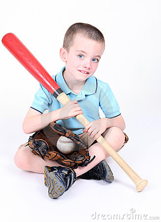 Boy holding a baseball bat with ball and glove