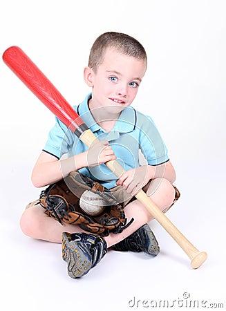 Boy holding a baseball bat with ball and glove