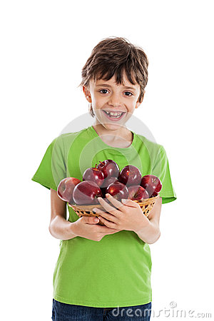 Boy holding basket of red apples isolated on white