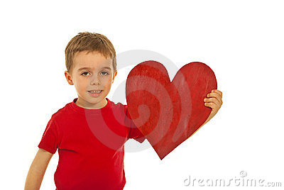 Boy holding big heart