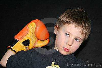 Boy holding boxing glove
